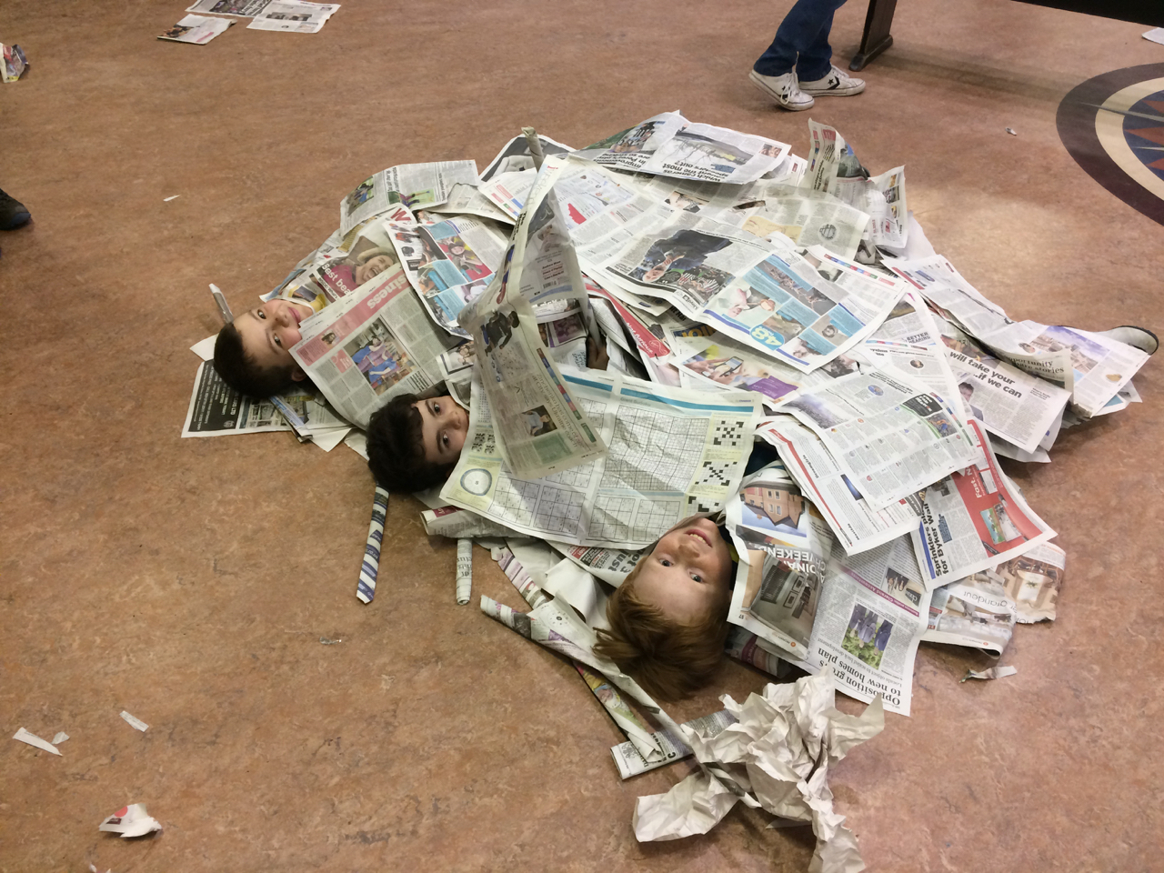 Scouts buried under a heap of paper.