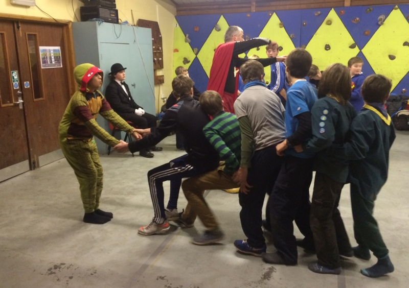 Teams of Scouts playing games indoors. The fancy dress theme was super-heroes.