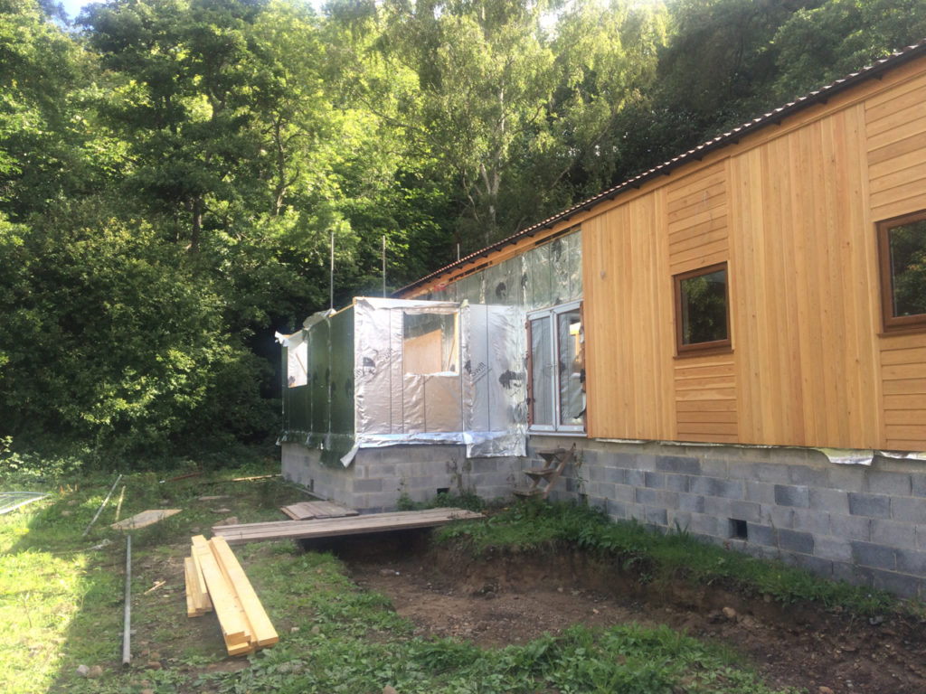 New insulated panels mark the location of the kitchen