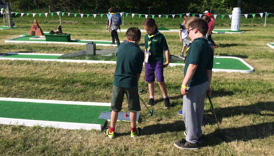 Cubs demonstrating their skills on the crazy golf course