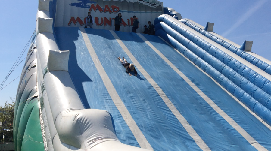 Scouts sliding down an enormous air slide