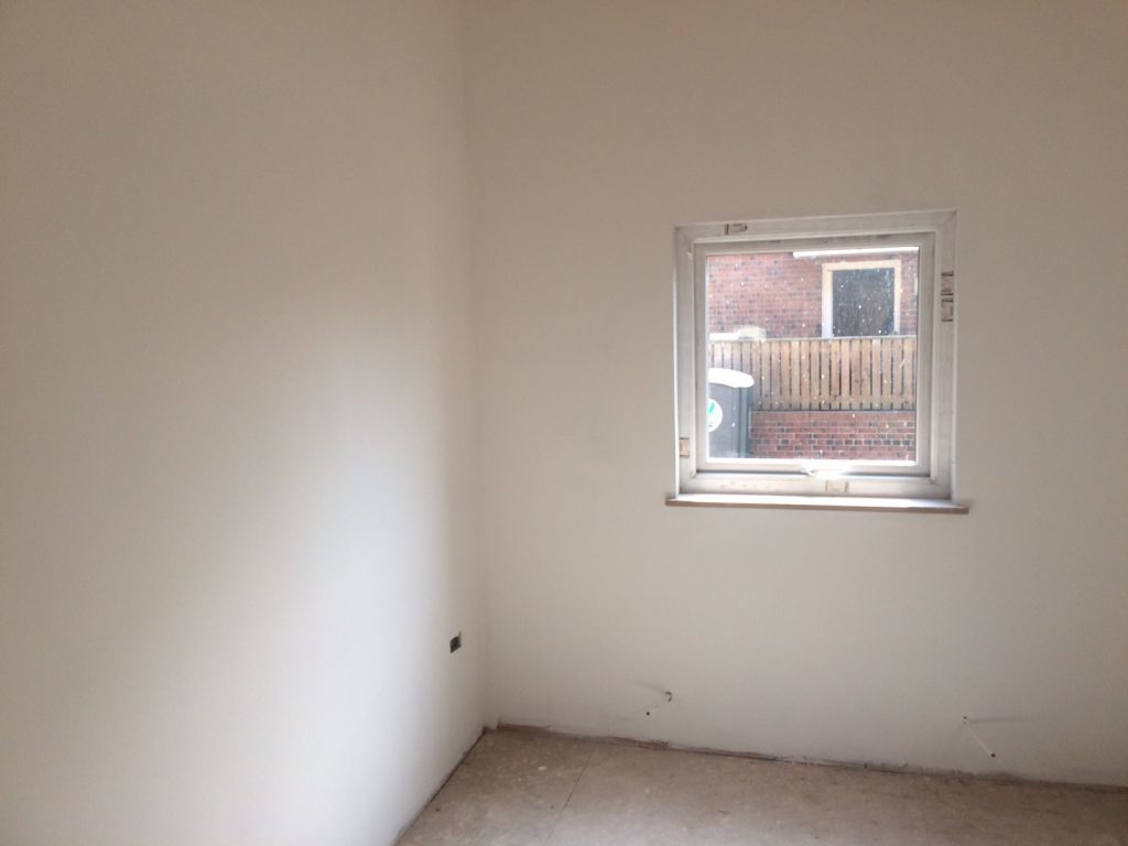 Meeting room with newly plastered and painted walls