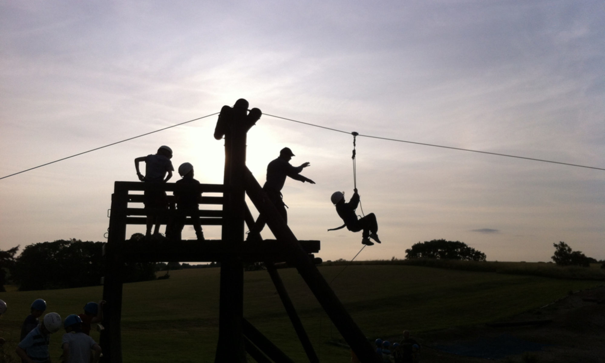Silhouette of Scouts on a zipwire