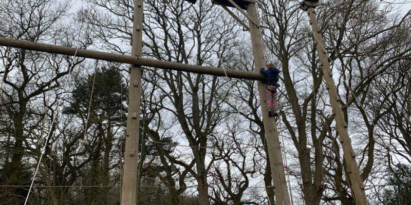 Attempting the high ropes course