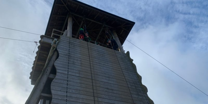 A Cub about to lean over and start abseiling