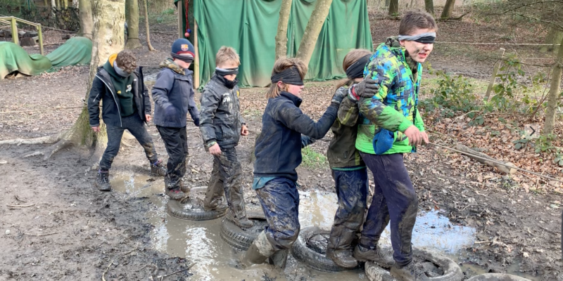 The rope leads them through muddy puddles