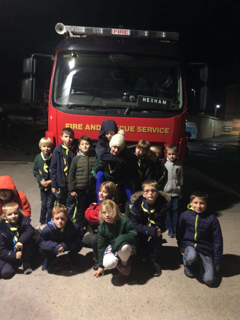 Cubs sat in front of a fire engine