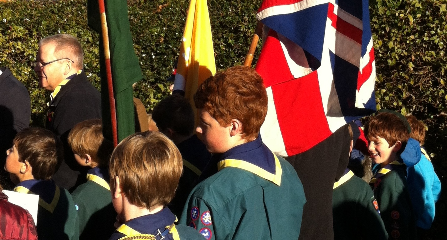 Scouts carrying flags